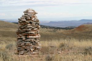 This is a wonderful and mysterious rock pile or cairn. An ancient structure, many believe these were built by the early Native American Indians and served as a celestial monument. By the 1800's, these lichen covered stone piles were used by sheepherders as guides. Has a Zen-like quality. May be used to illustrate growth, success, guidance, inner peace, personal direction and more.